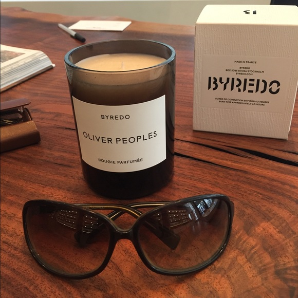 Oliver Peoples wrap-around style sunnies.
